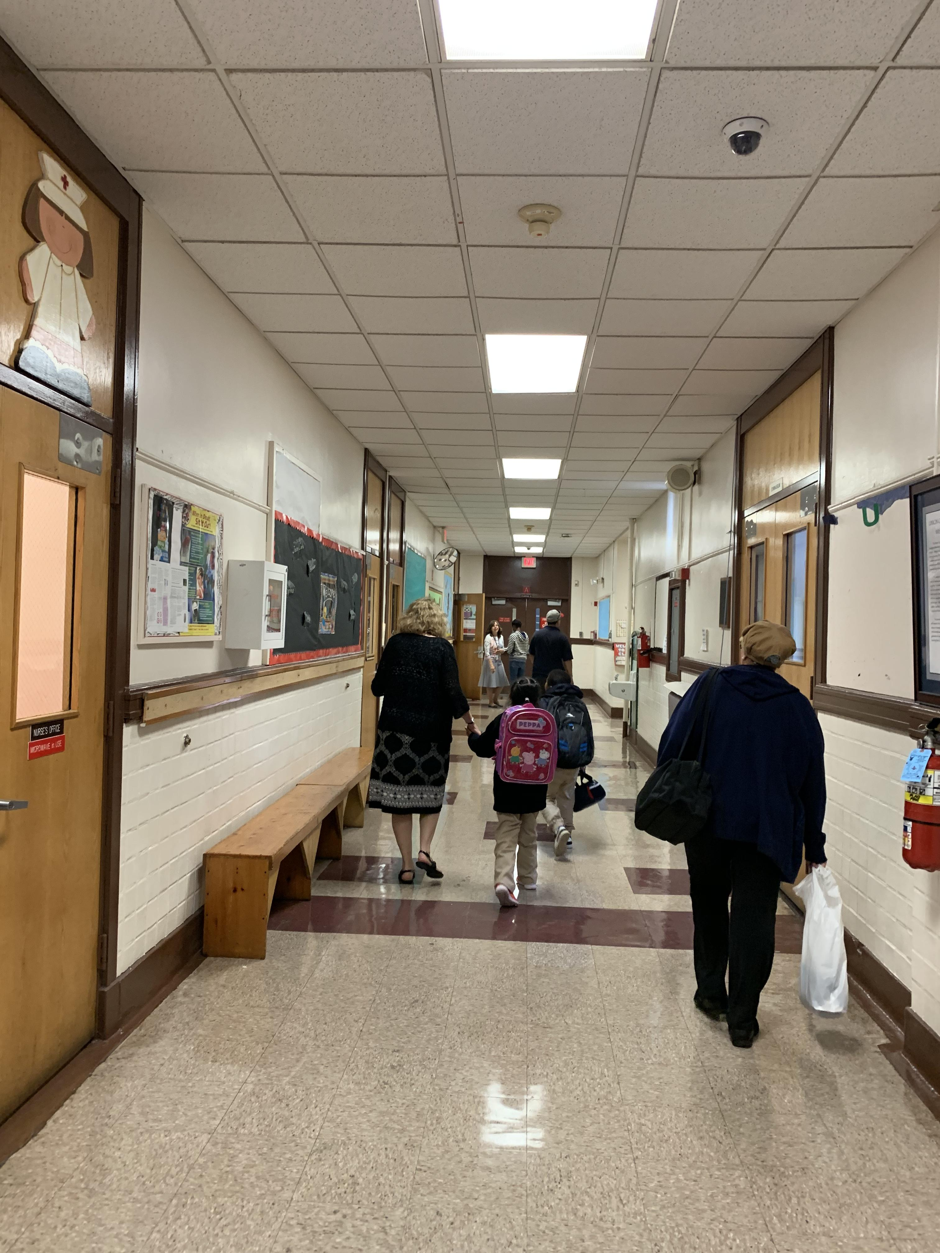 ms. o´connell walking student to her new class