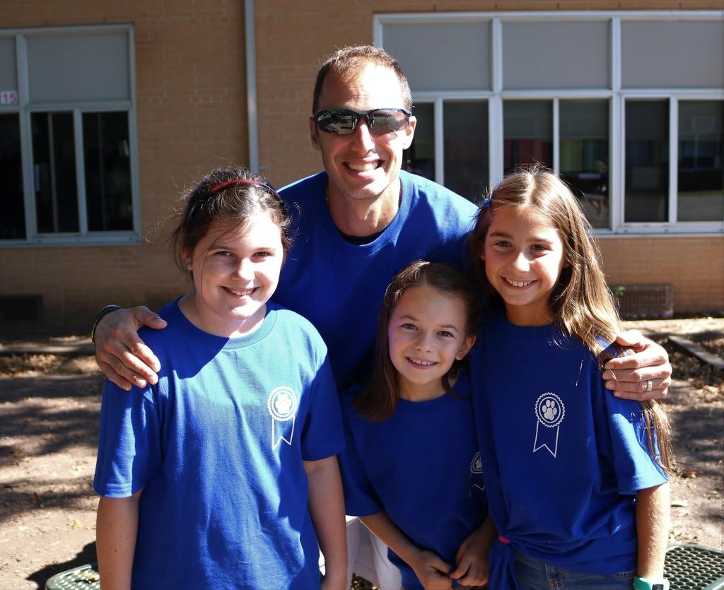 Photo of Washington School students and teacher wearing special National Blue Ribbon School shirts.