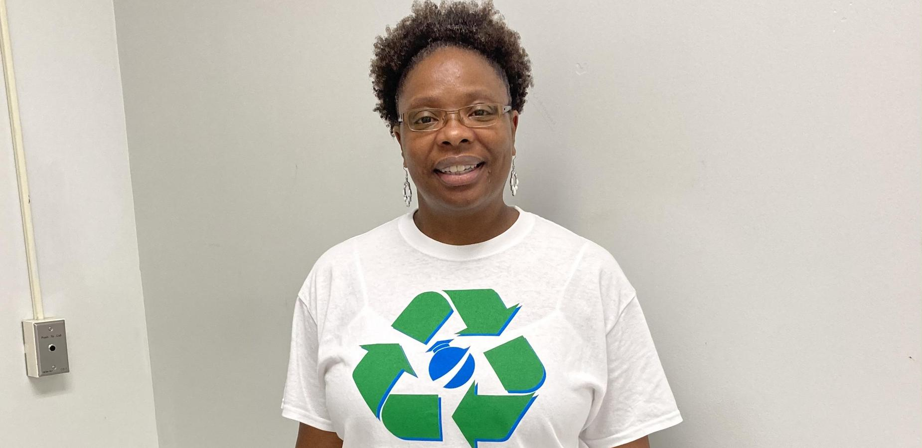 Ms. Pauling wearing her GOA Recycle Shirt