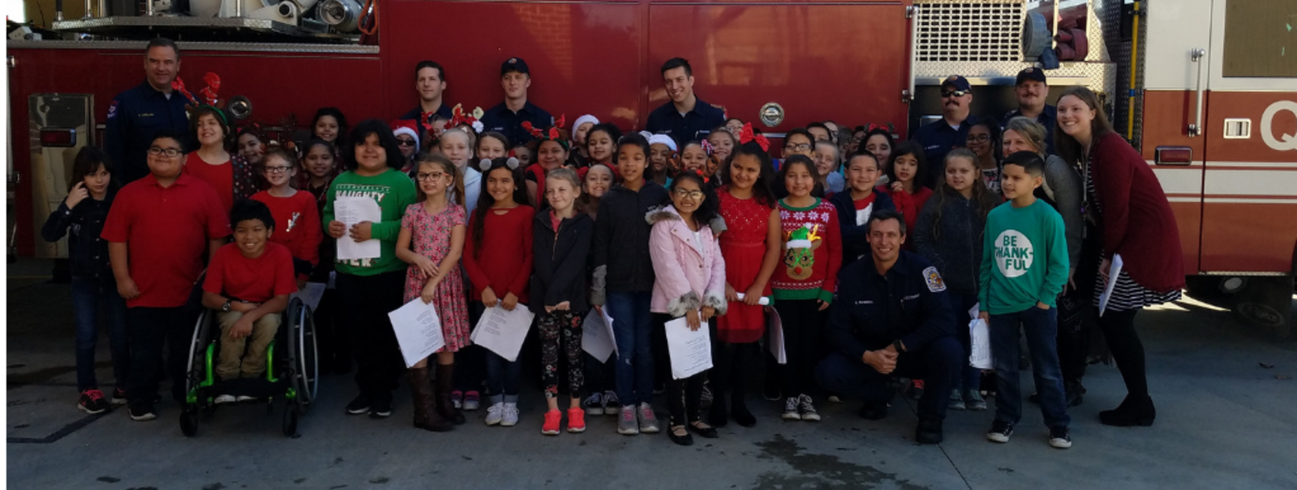 carolers and fire truck