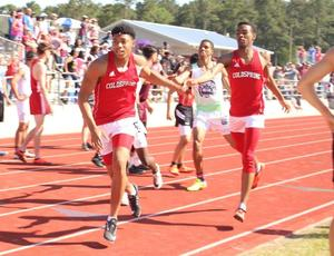 Photo of the hand-off during the 4x400m race at Area