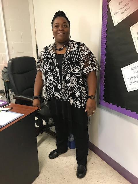 Teacher dressed in black and white for Blackout Day