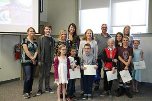 Students being recognized at a board meeting