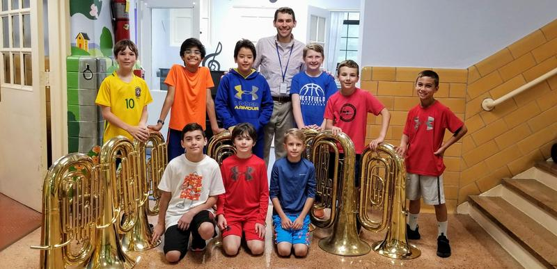 Photo of Franklin School tuba players with band director Aaron Staluppi.