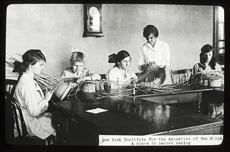 Class of young girls making reed baskets circa 1890