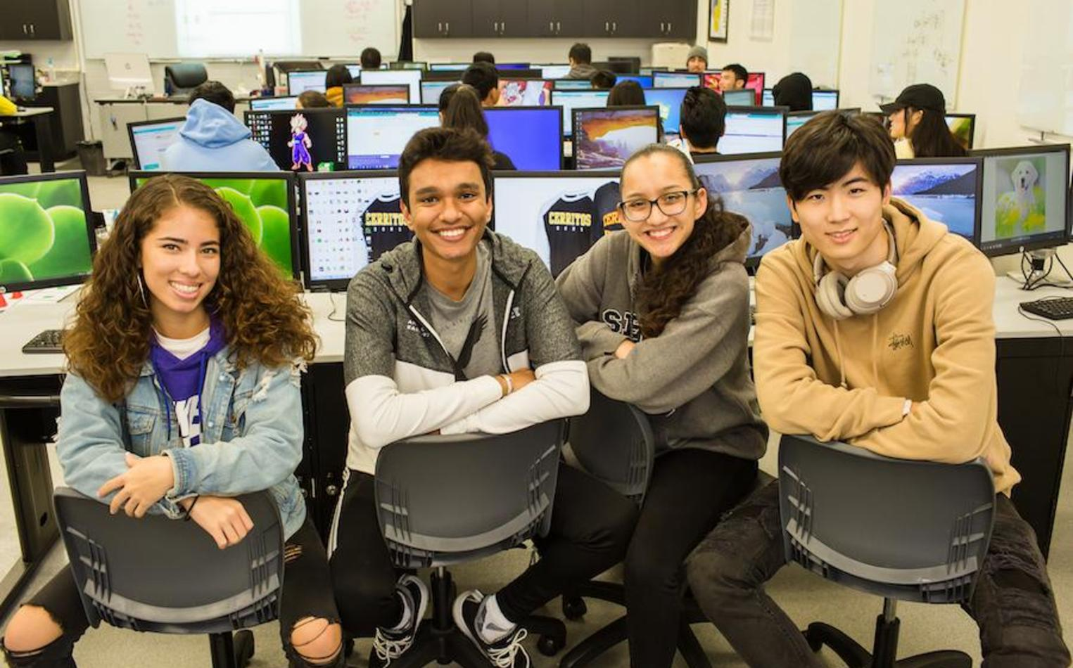 High school students posing together in computer lab.