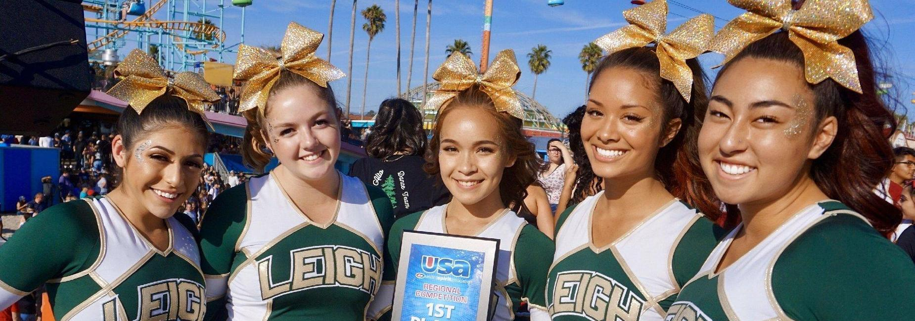 Five Leigh cheerleaders posing with first place award