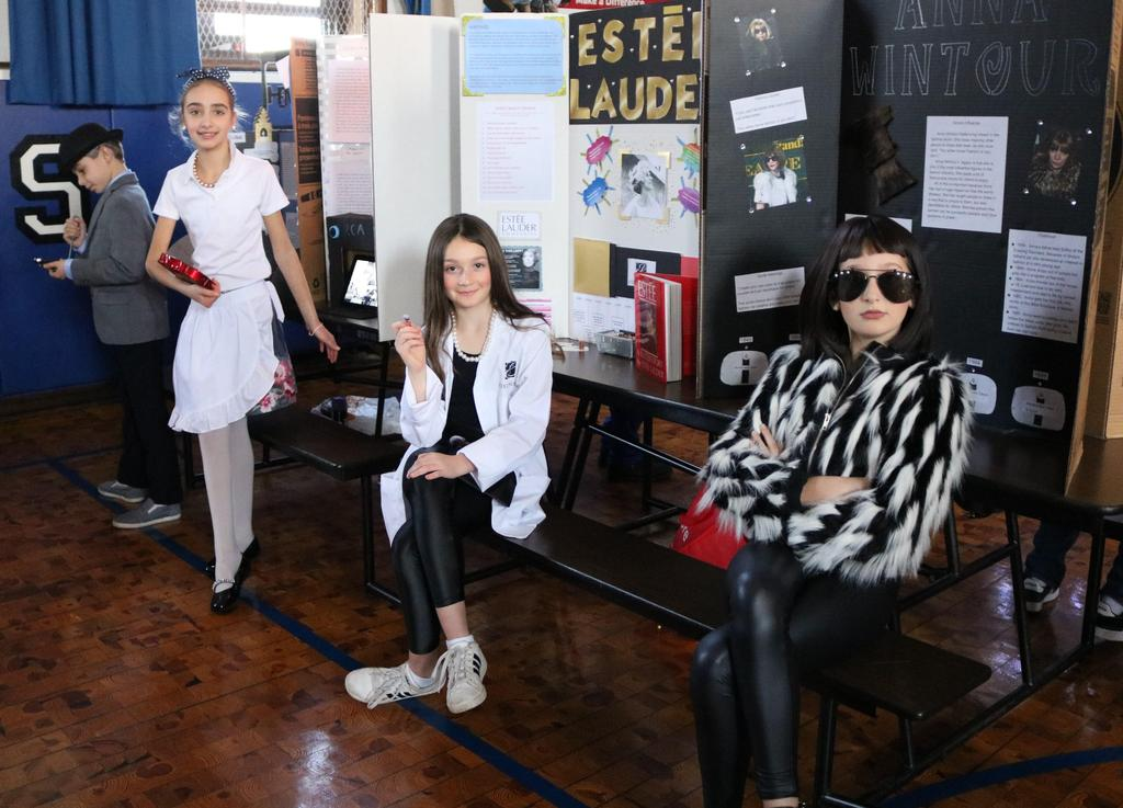 "Photo of four Wilson 5th graders dressed as famous persons during annual ""Wax Museum"" event."