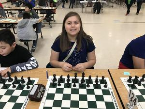 student ready to play chess.