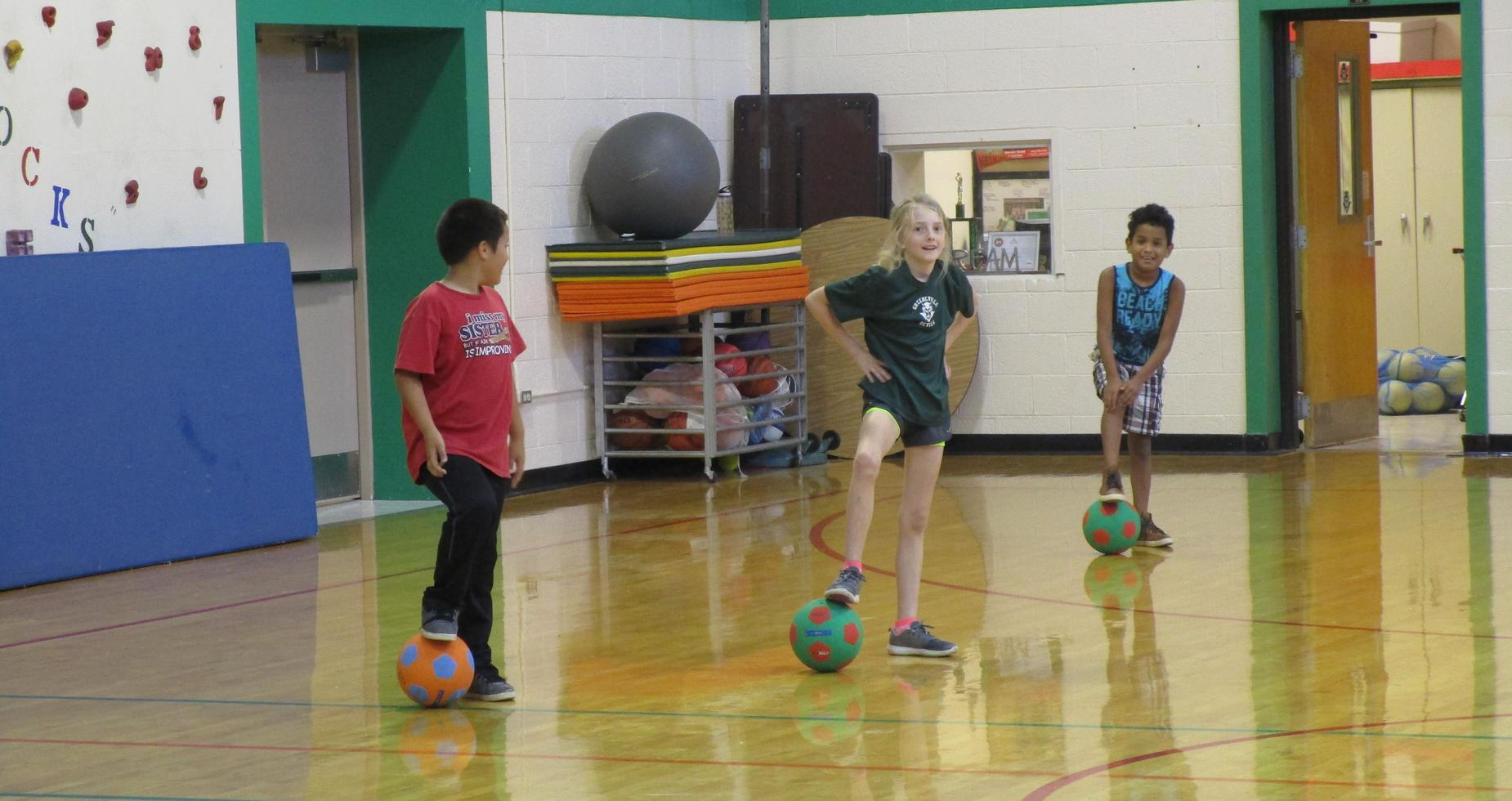 fourth graders playing in gym