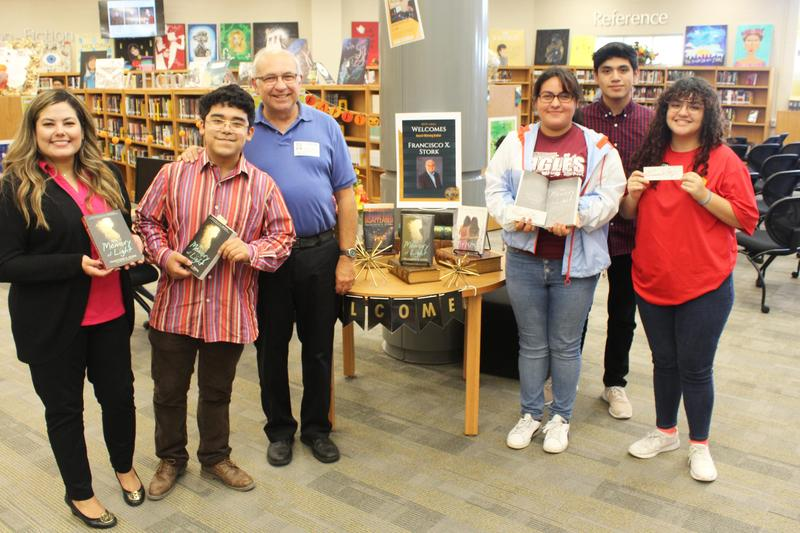 MCHS students and librarian with author Francisco X. Stork.