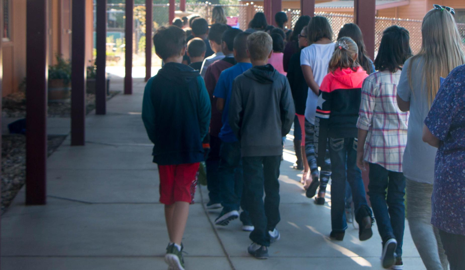 Students walking down the hallway
