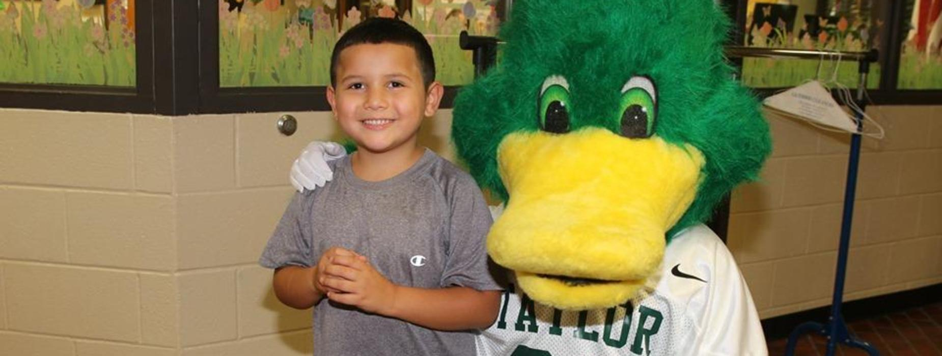 student with duck mascot