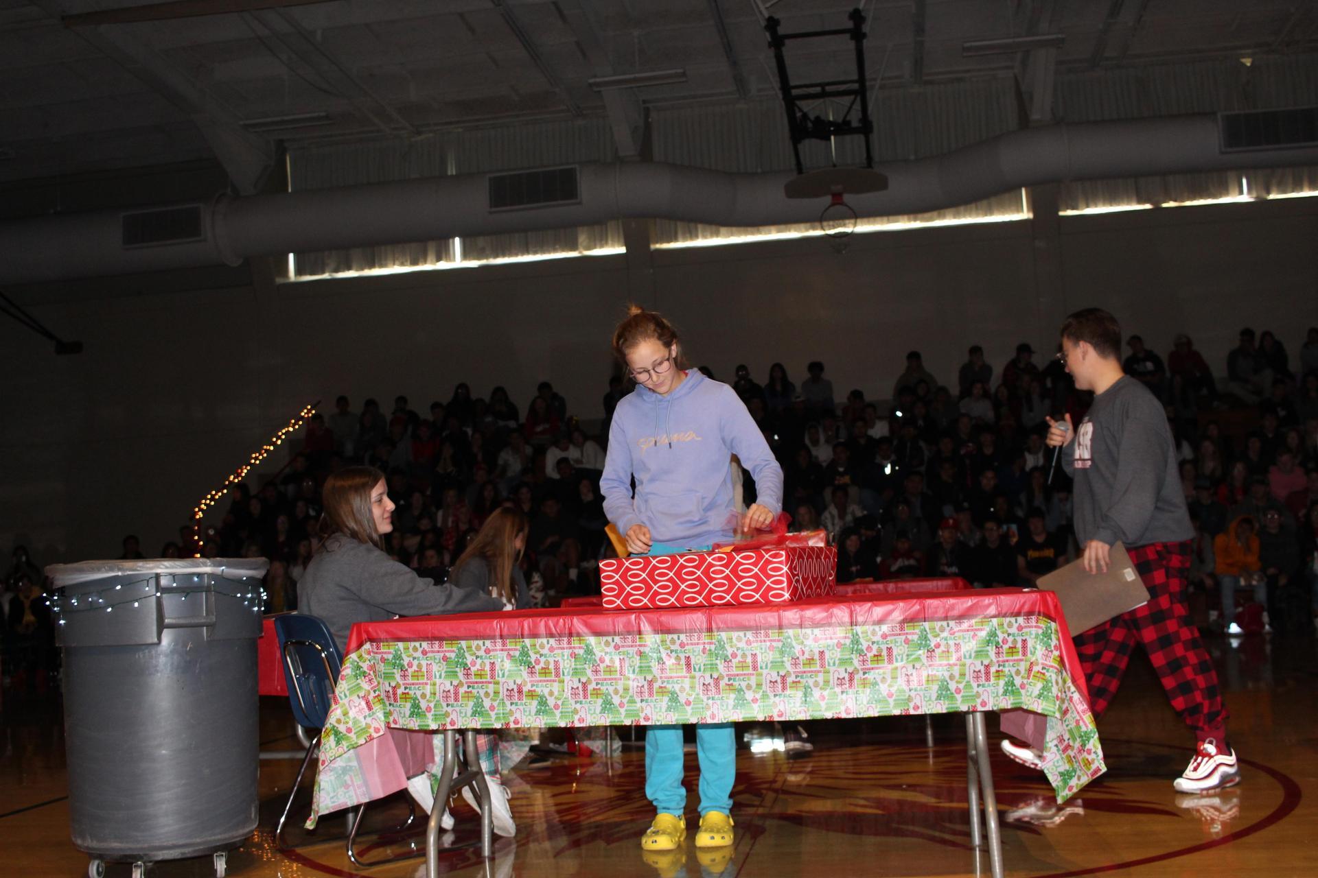 Lauren Bass opening her gift