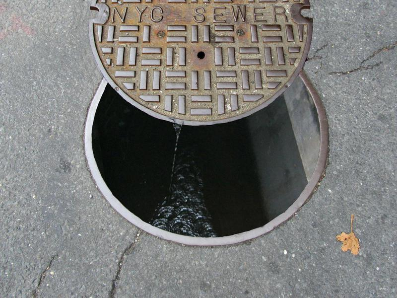 NYC manhole cover over sewer