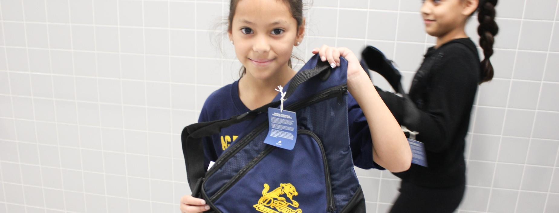 student with backpack gift