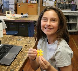 STEM camper displays a 3-D hashtag she created during STEM Camp.