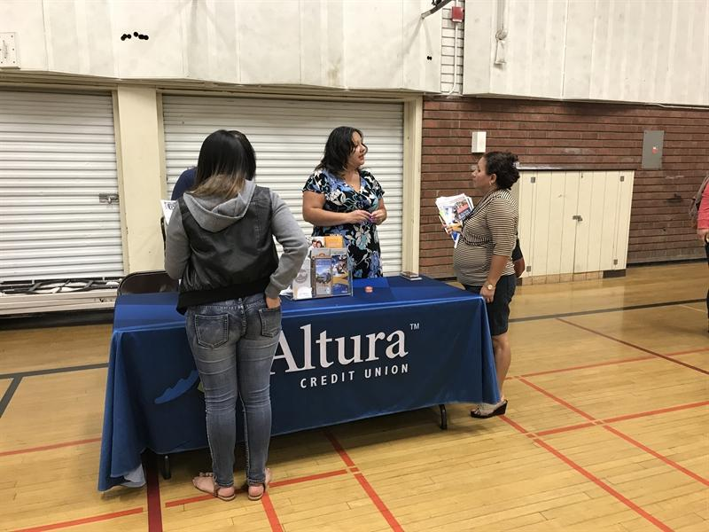 Resource Summit Event held in gym student at Altura table