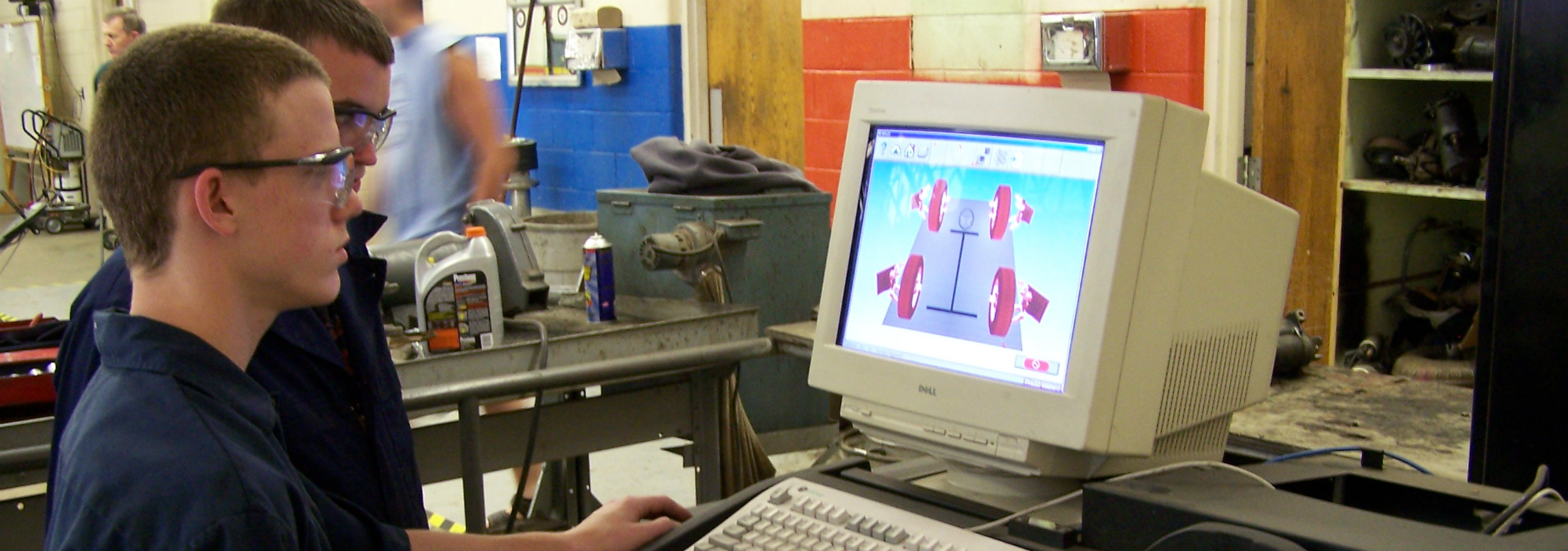 Students at Smyth Career & Technology Center use computerized tire alignment tool.