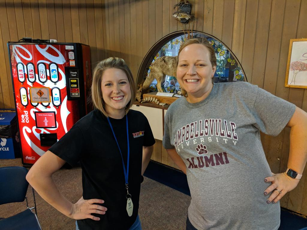 Two teachers smiling for their picture