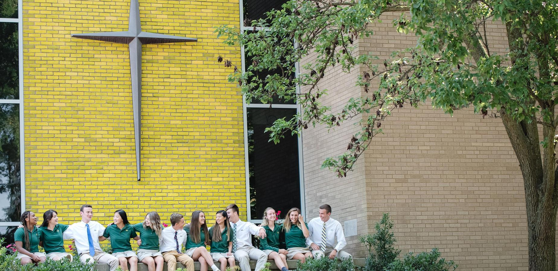 Students laugh together outside