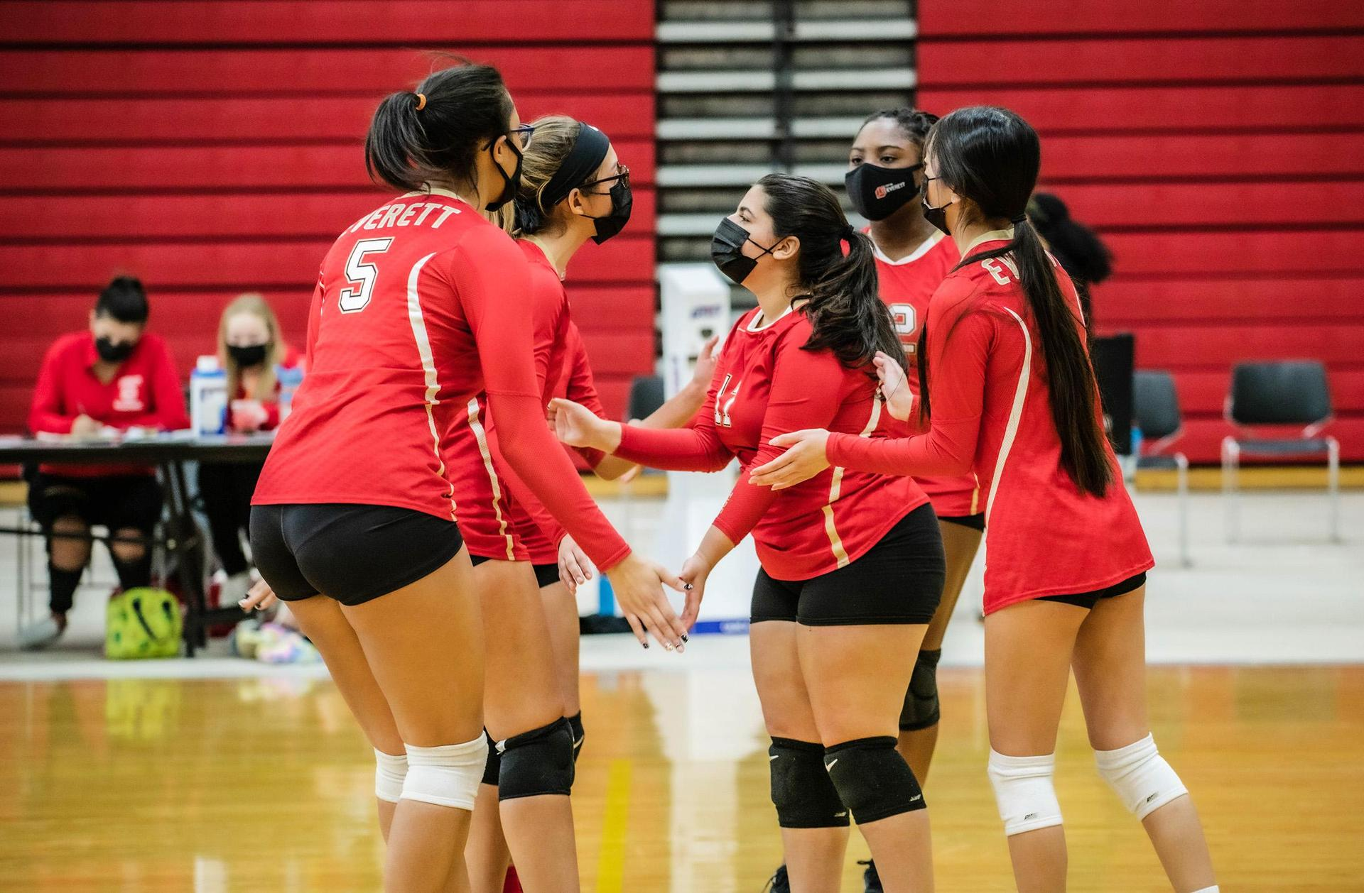 Volleyball players huddle up
