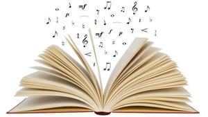 Image of open book with music notes