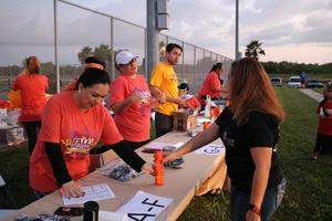 Mission CISD Risk Management and other Central Office staff helping with registration at the 5K.