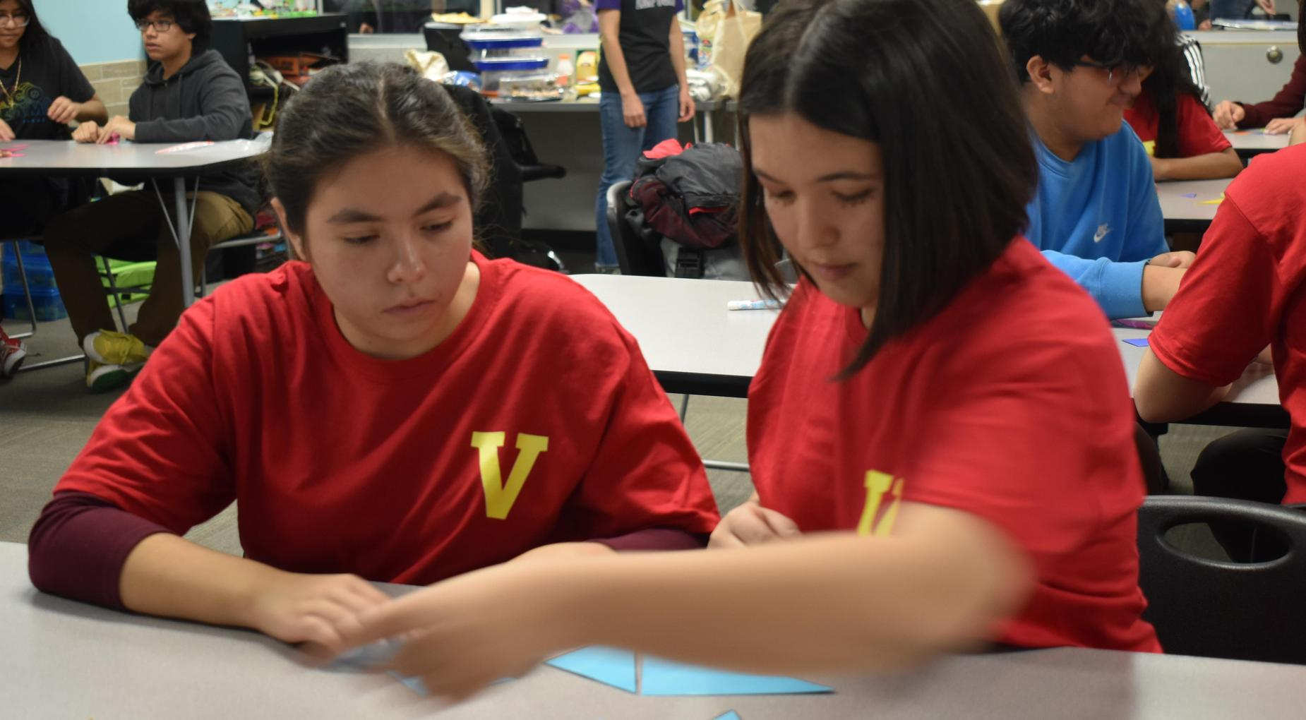Students from House Veneratio solving math puzzle during House Olympic