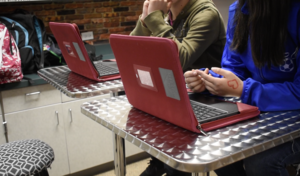 Close up of a chromebook and a students hands typing