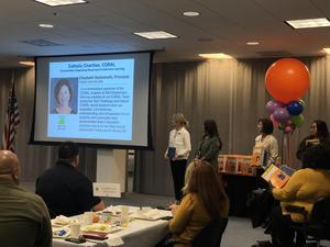Principal Liz Herbstreith receiving her Breakfast of Champions Award