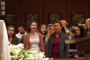girls singing in church pews