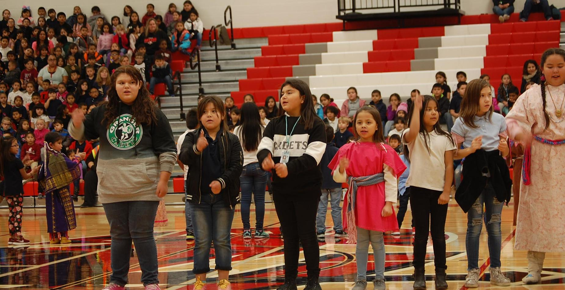 JOM Students performing at the Native American Heritage Assembly