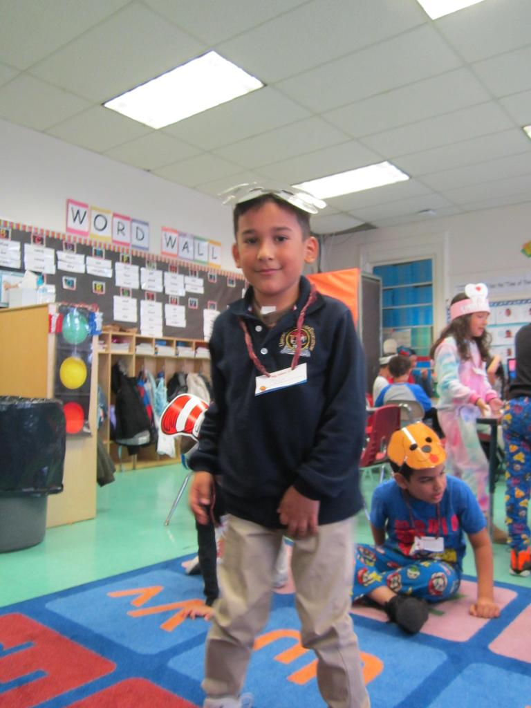 boy in school uniform wearing a dog mask standing on the class rug