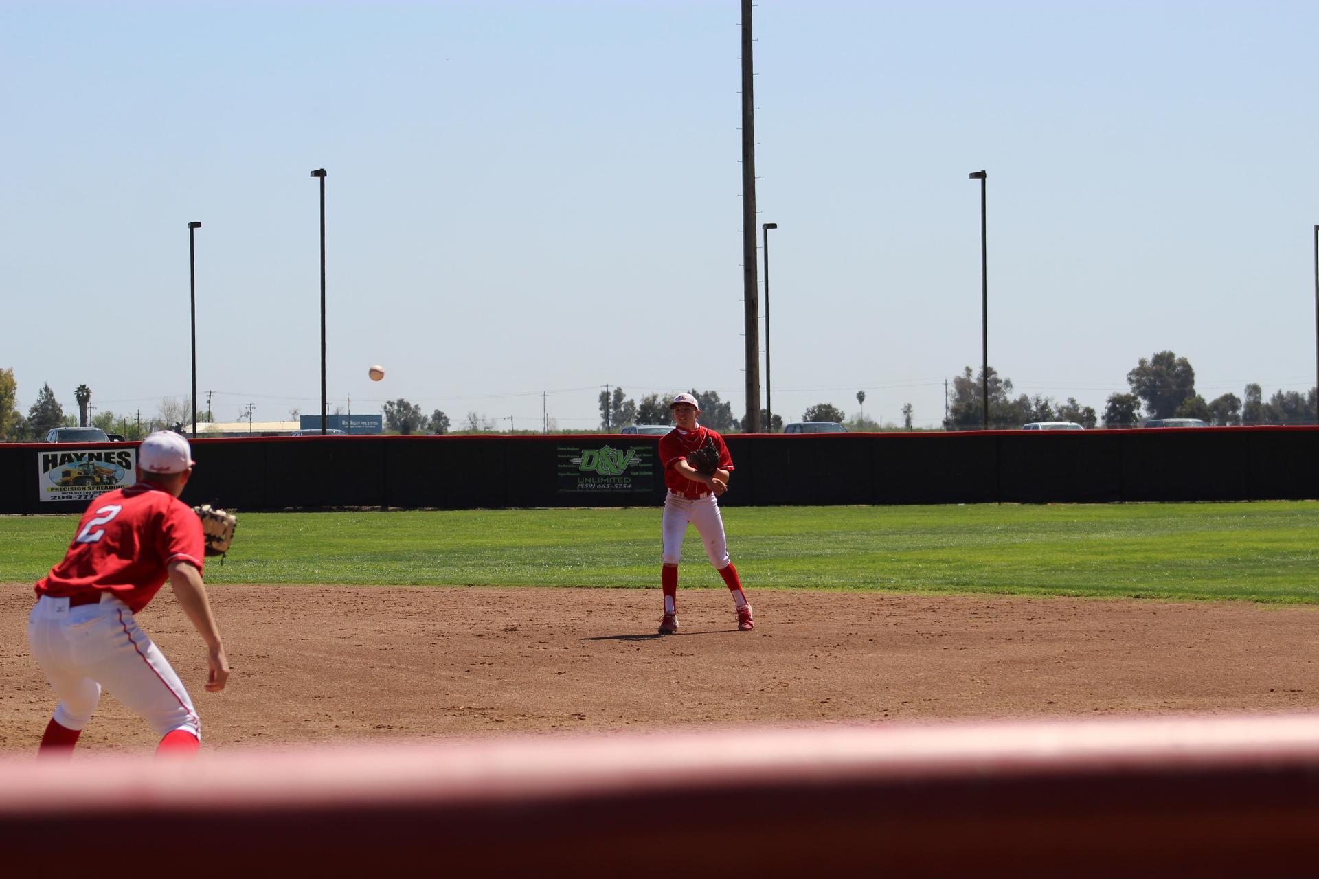 boys playing baseball against San Joaquin Memorial