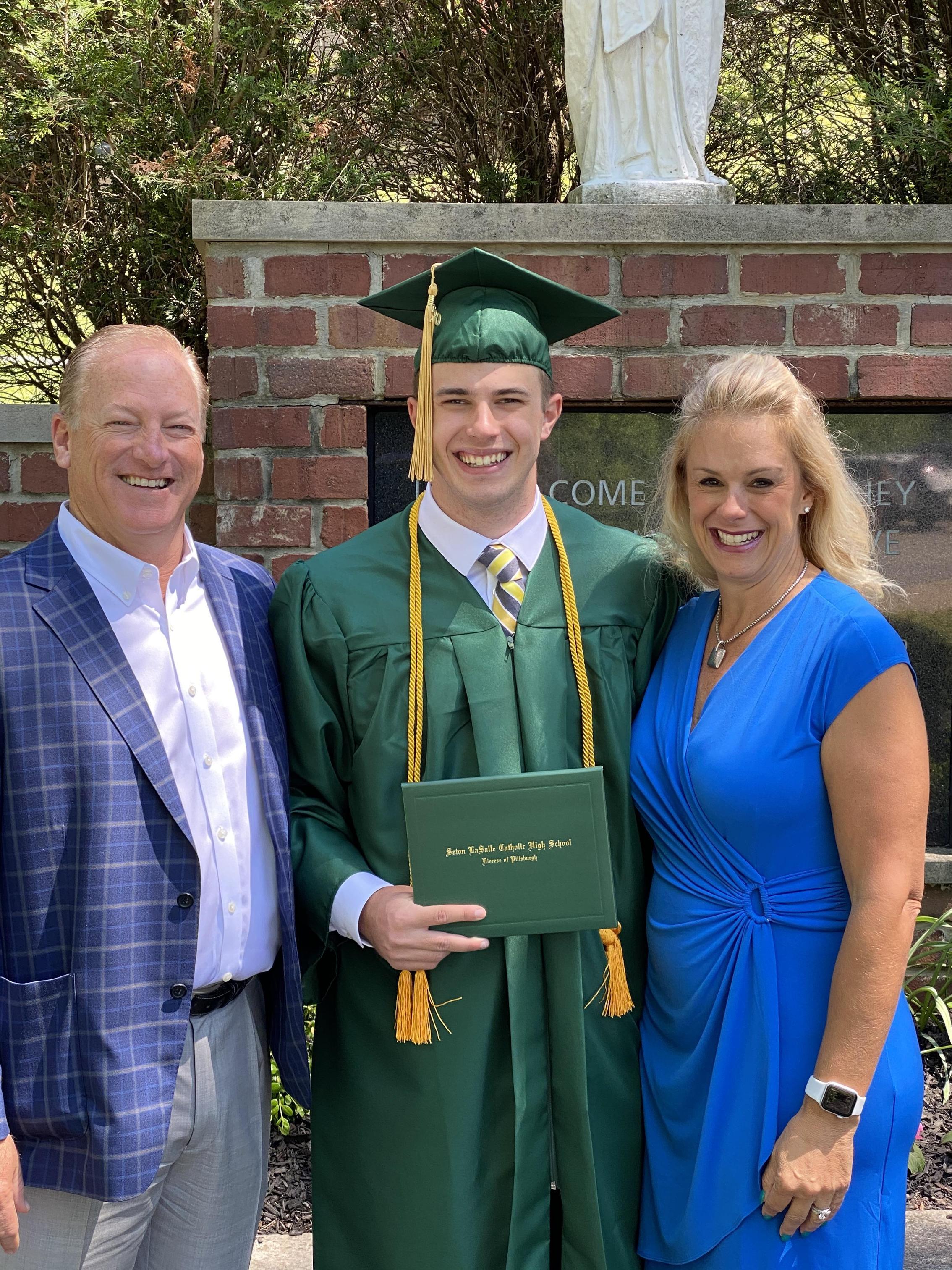 Boy graduate with parents