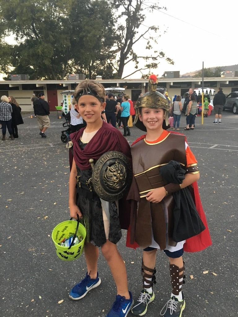 two boys dressed as spartans