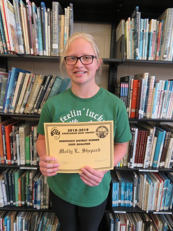 Molly Shepherd receives her essay award.