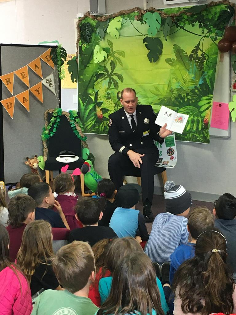 firefighter reads to students