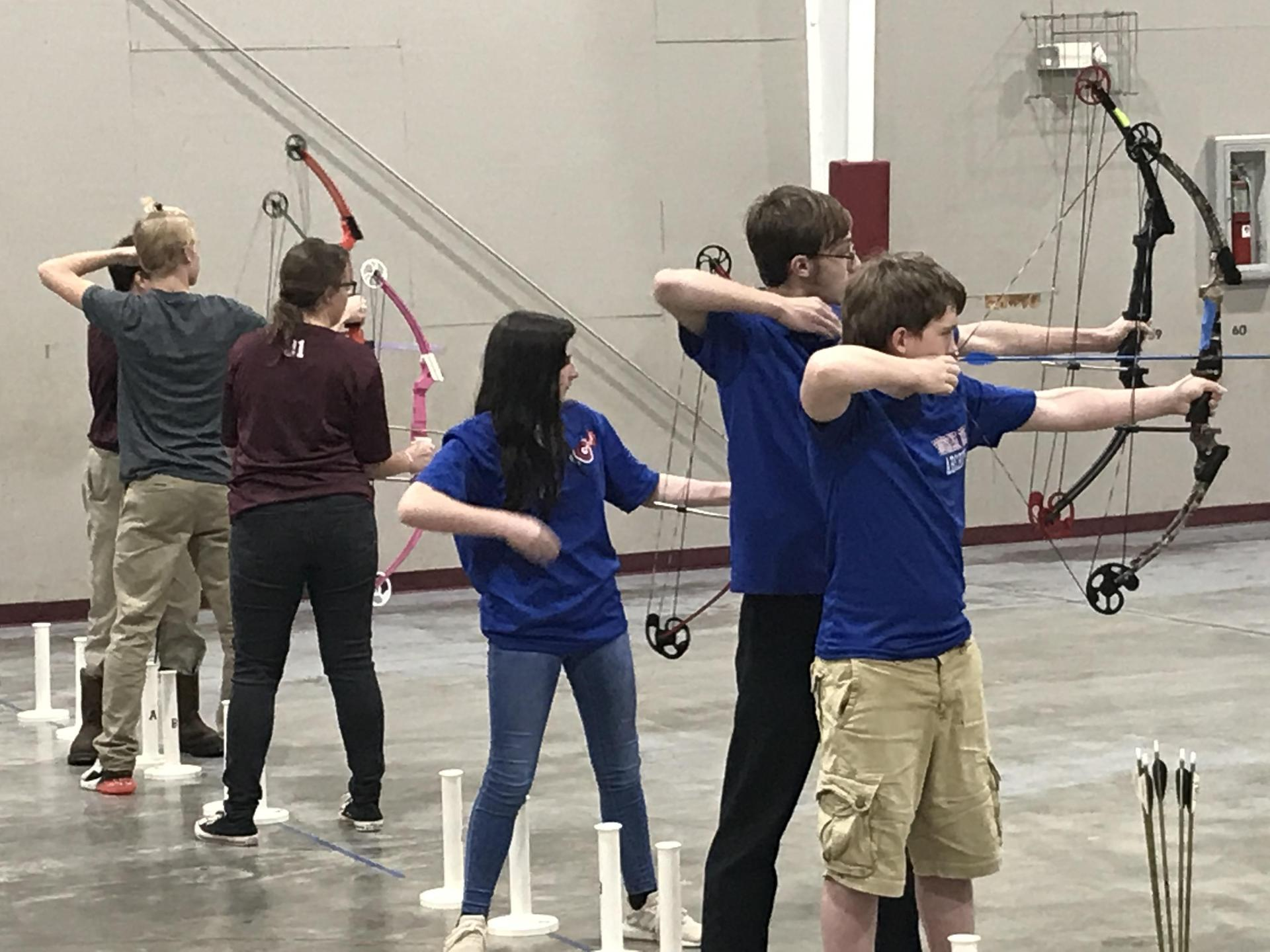 Southeast and Clarkdale archery athletes competiting.