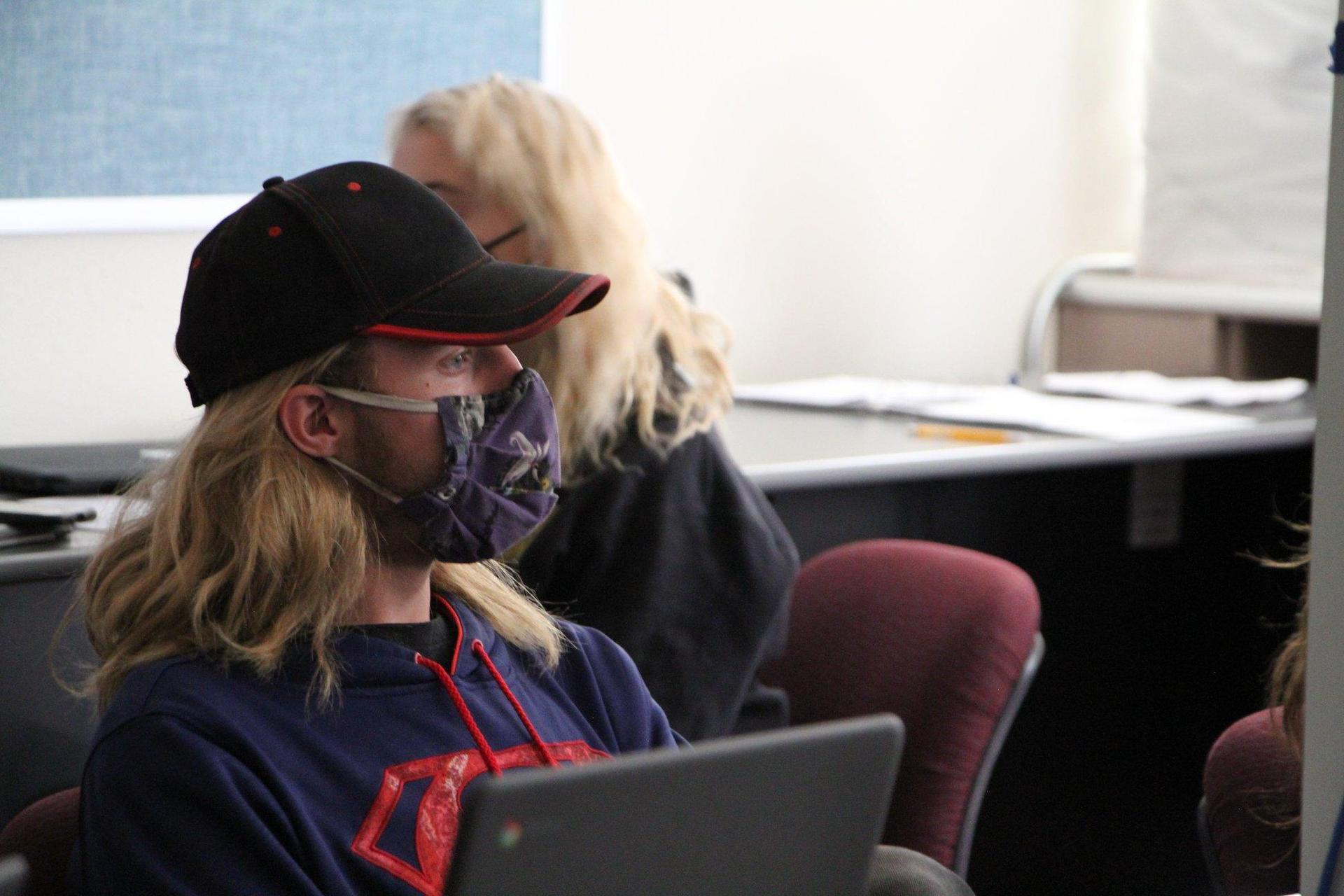 Boy sitting in classroom