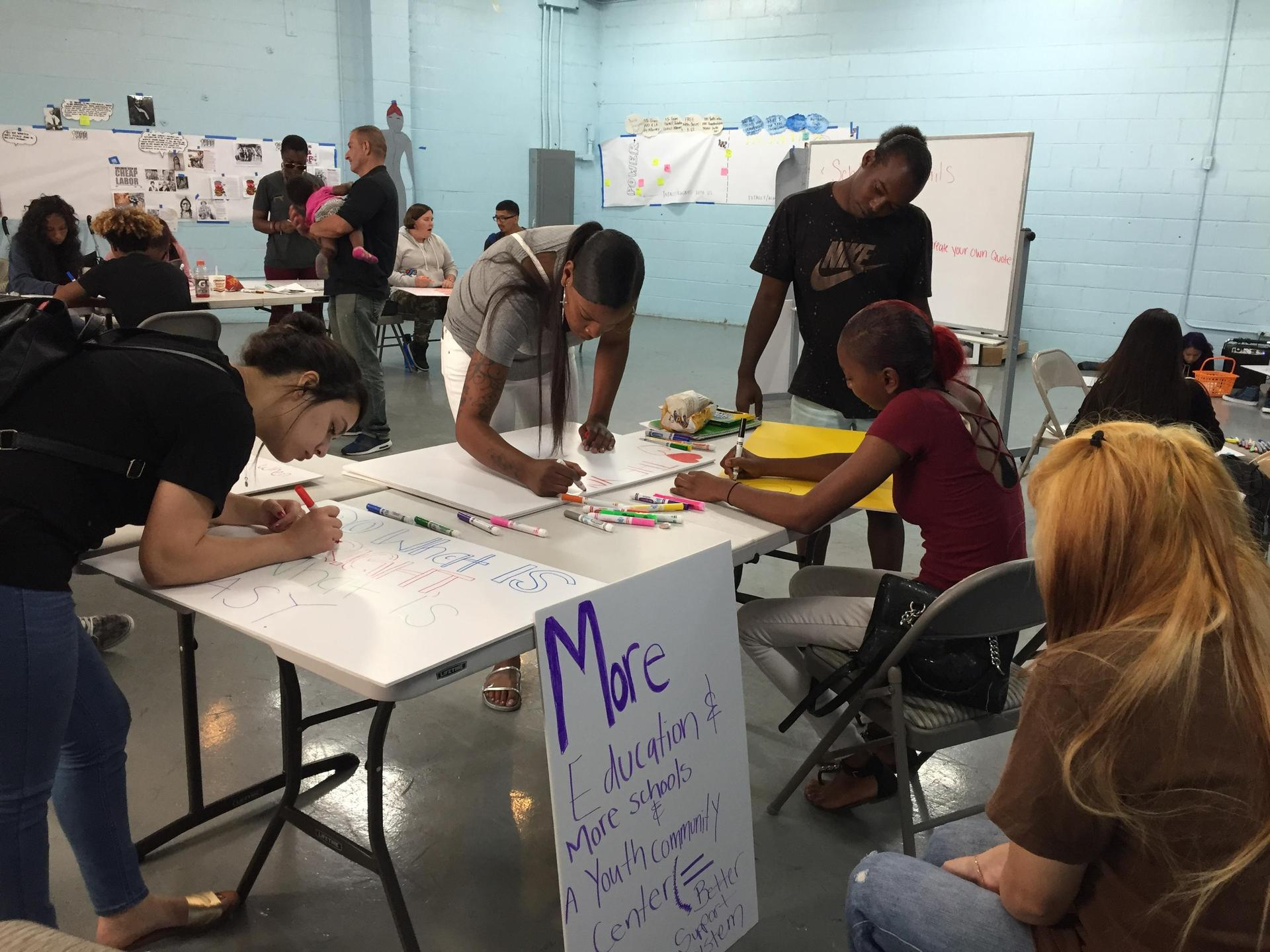 YJC students making signs as part of their Street University