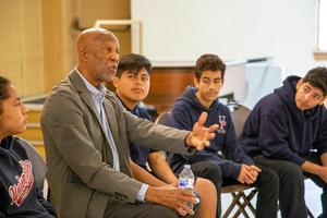 Dr. Roberts speaks with high school students