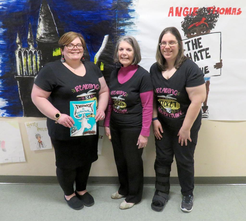 Posed photo, three educators
