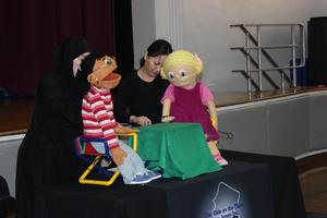 boy and girl puppet from
