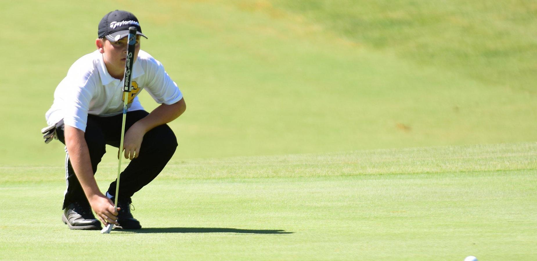 Golfer sets up for a putt