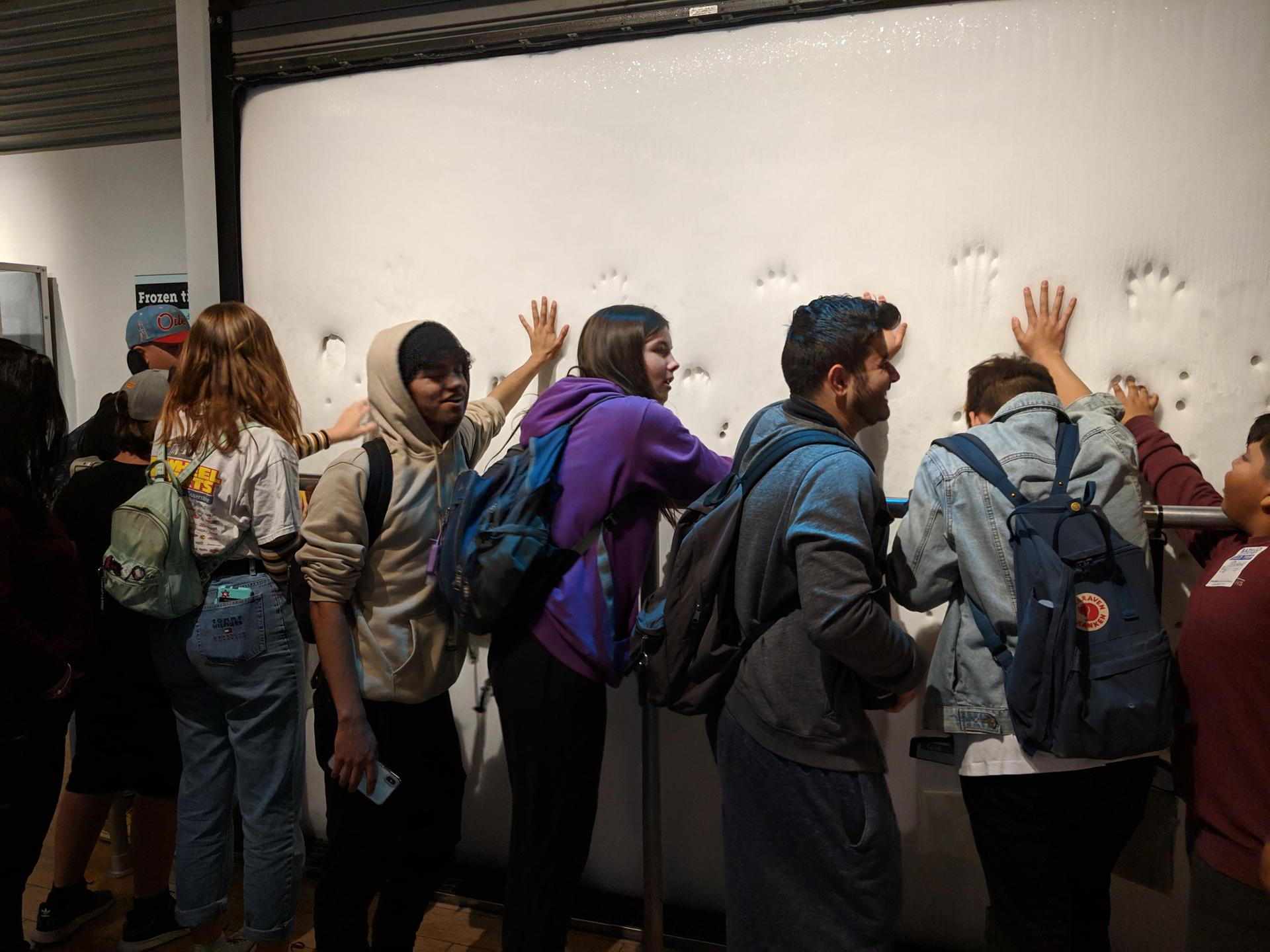 students feel a malleable wall during their field trip to the California Science Center
