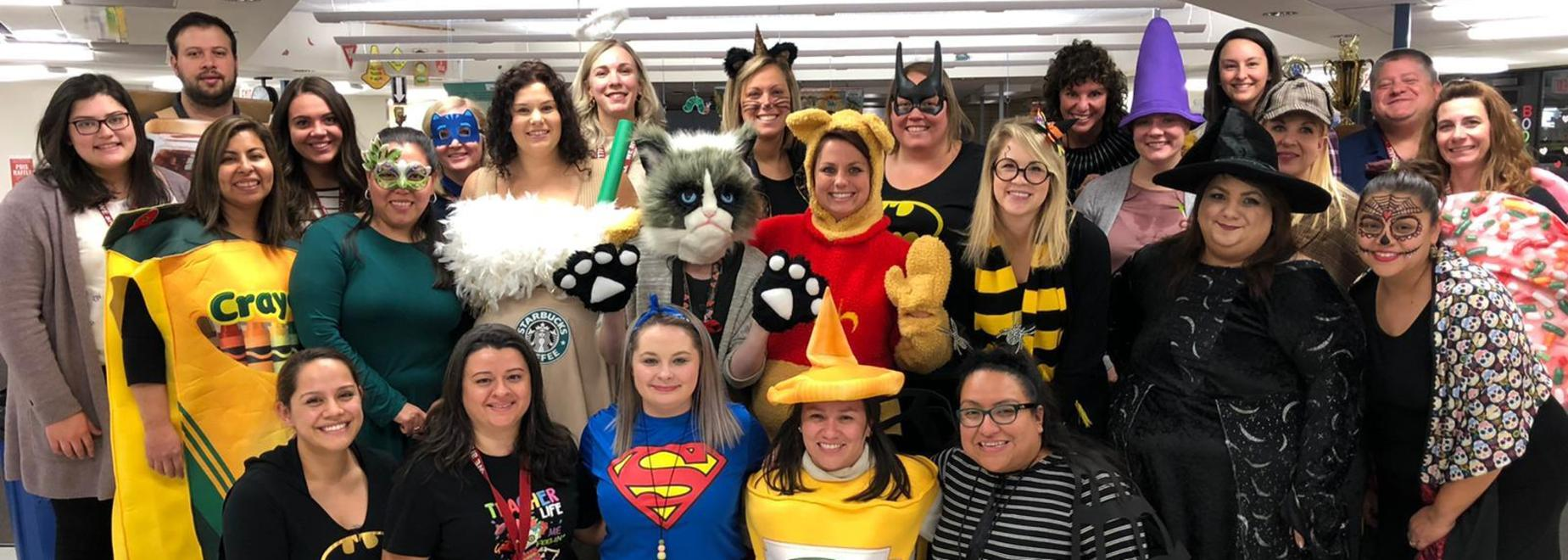 Teachers in Halloween costumes at Literacy Night
