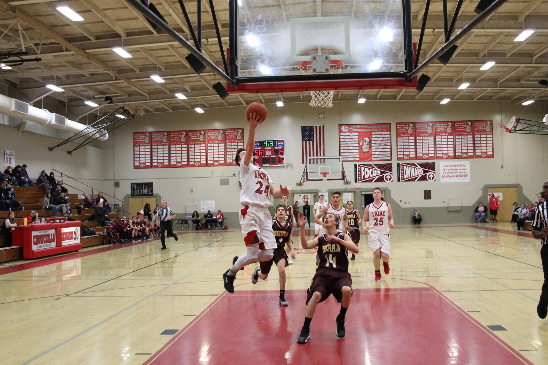 JV Boys playing basketball vs Sierra