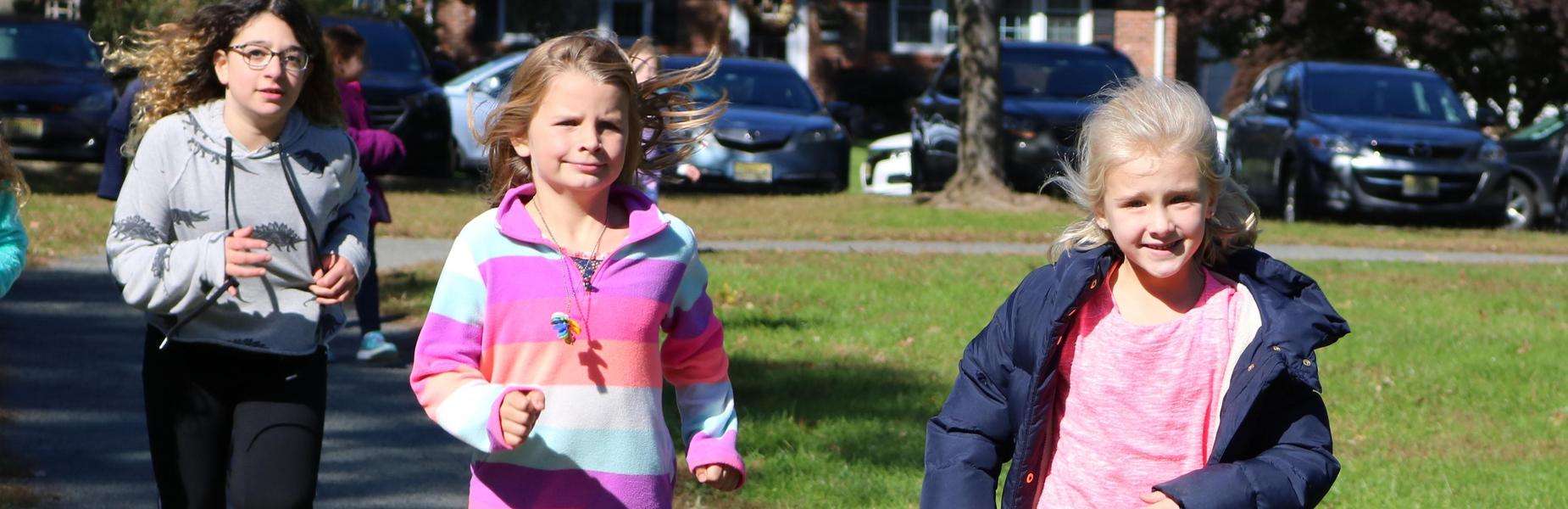 Washington School students run laps as part of the Recess Runners' Club.
